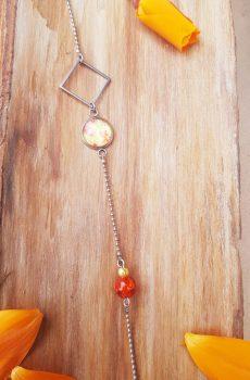 Headband inox fait main - Losange argenté, cabochon fleurie et perles d'imitation jaune et orange. Calino crea